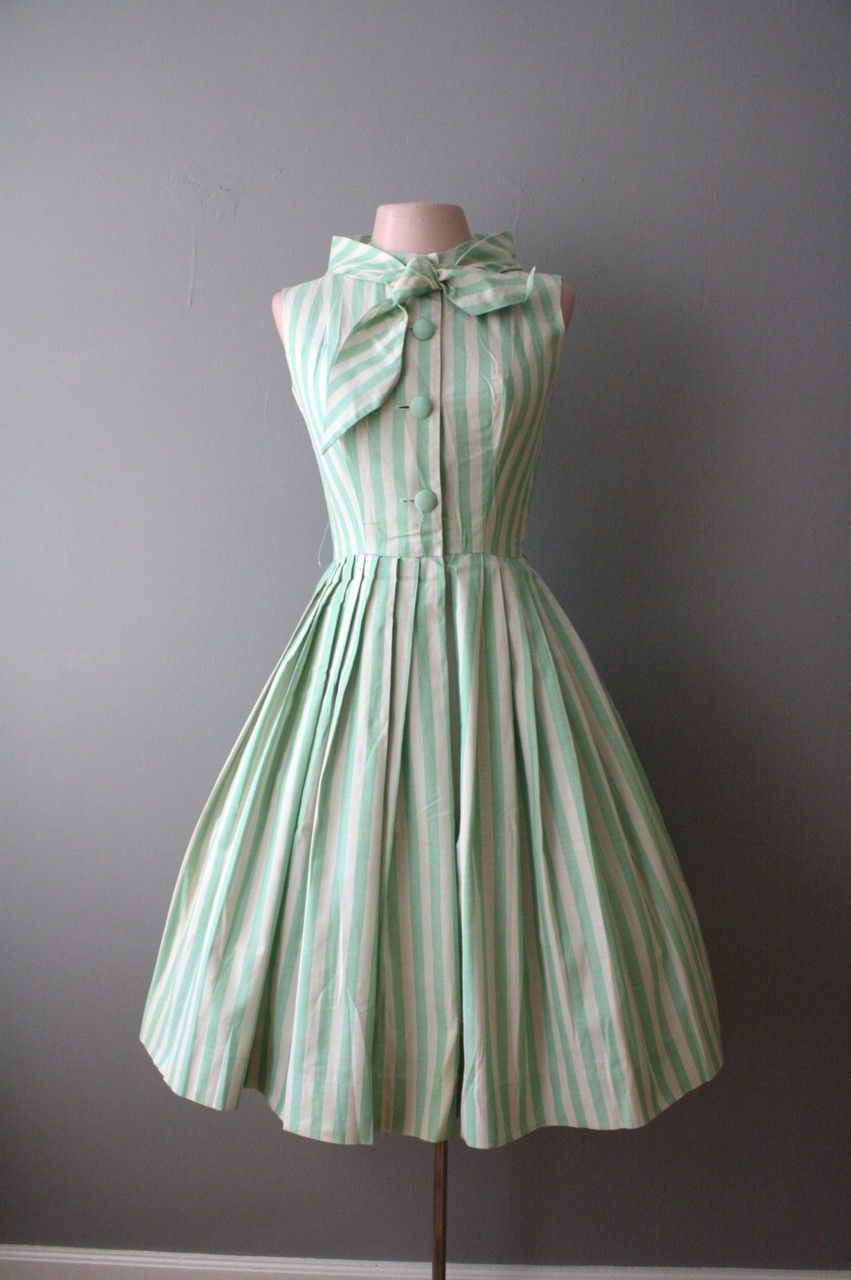 This mint striped vintage dress is adorable! I absolutely love how the dress is colored and the bow detailing added to the neck! Want this in my closet!