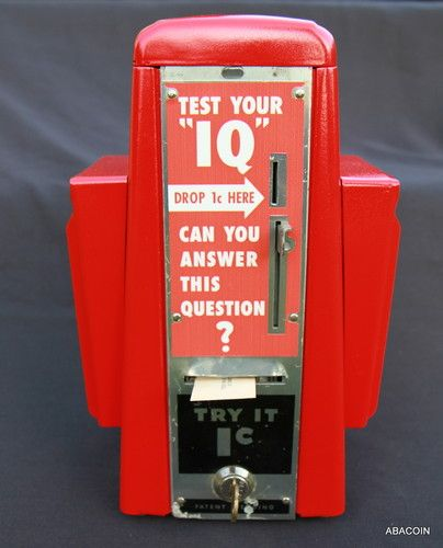 1950s vintage diner or soda fountain napkin dispenser and penny coin-op IQ Test machine.