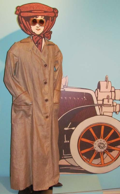 "Automobile Duster and Goggles, 1900-09  Linen with oilcloth trim. Goggles, leather with cotton binding; metal eyepieces with tinted glass; replacement ties. In the early years of the automobile, driving was as much a sport as it was transportation. Open cars required protective outerwear—a ""duster"" coat the color of the dust and mud sure to cling to the driver, goggles, and for ladies, hats firmly kept in place with long veils which kept dust off the face."