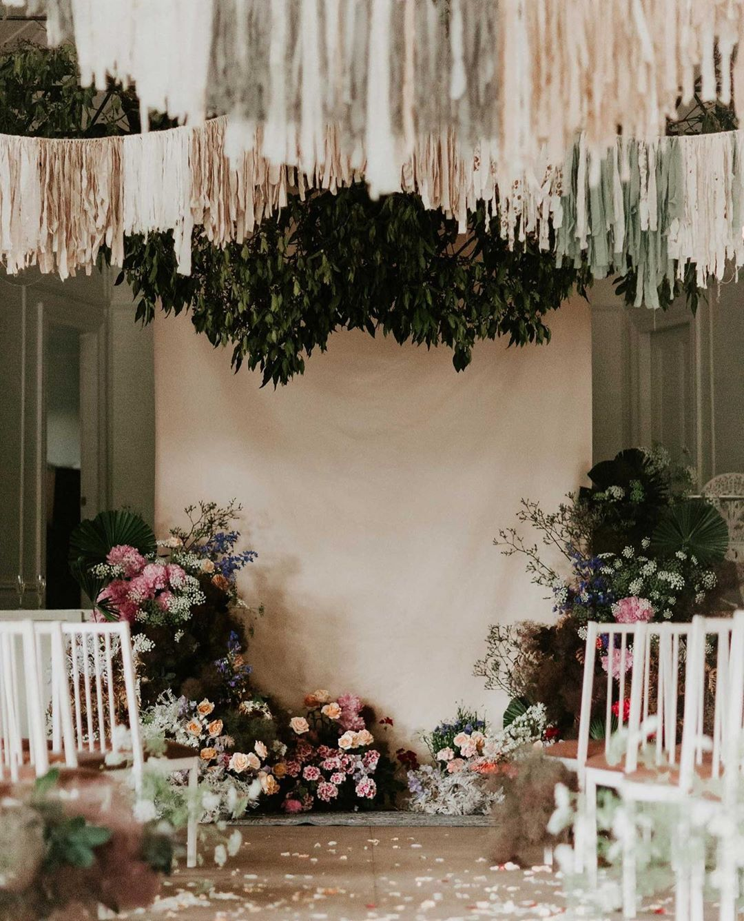 Diy tassels and florals for ceremony backdrop Wedding