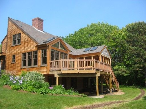 Custom Built Home On Cape Cod With Stained Wood Siding By Cape Associates Inc Custom Home Builders Custom Home Builders Custom Built Homes Home Builders