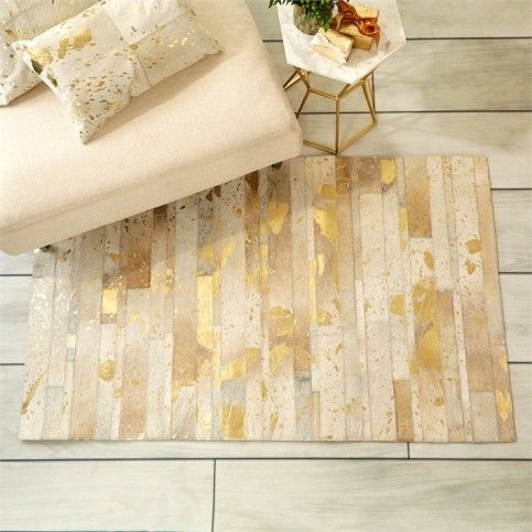 Golden natural cowhide area rug in metallic gold dream - Gold rugs for living room ...