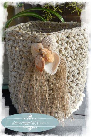 Coastal Chic.  Recycled Strips of Cotton Fabric Crochet'd into a handy little doo-dad basket.