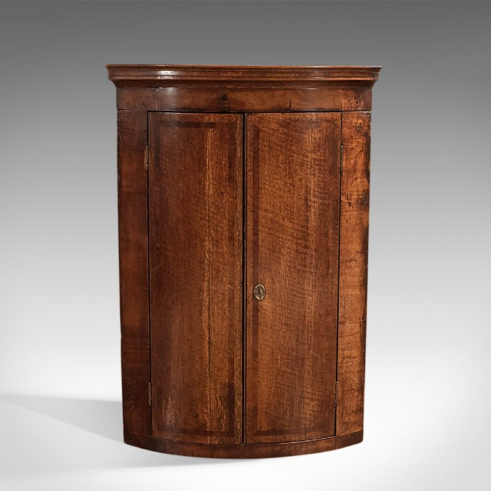 This Is An Antique Georgian Bow Fronted Hanging Corner Cabinet Which Deep And Rich In Colour With A Desirable Aged Patina