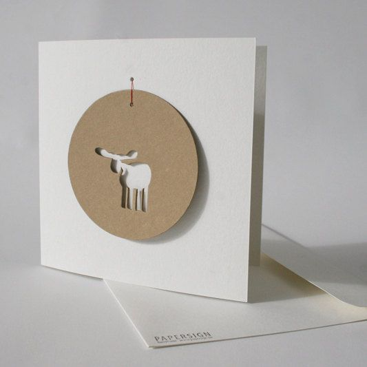 minimalist but expressive christmas card with 1 tag, handmade in germany. card and tag are made out of recycling board from the paper mill GMUND. card