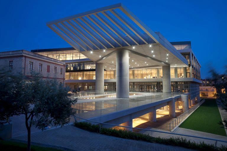 The Acropolis Museum, Athens, Greece.  The ground floor gallery houses finds from the slopes of the Acropolis. The transparent glass floor provides a walk over history, with a view of the archaeological excavation, while sloping upward to the Acropolis with sanctuaries of the Athenians from each historic period nearby.