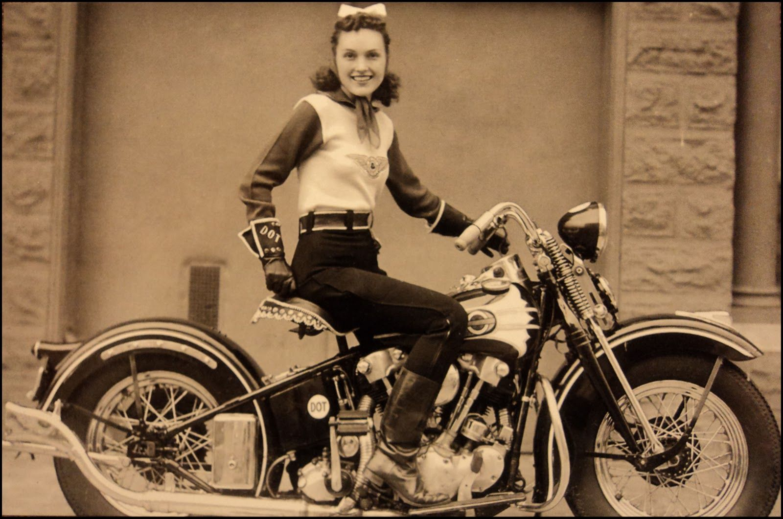 """This is Dot Smith, the famous female stunt rider from the 1930s and 40s, she was a member of the San Francisco Motorcycle Club and a founding member of the iconic """"Motor Maids"""" with Dot Robinson and Linda Degeau.    In this photograph she's sitting on her 1937 EL Knucklehead and looking damn near perfect with that little ribbon in her hair. They just don't make 'em like they used to"""