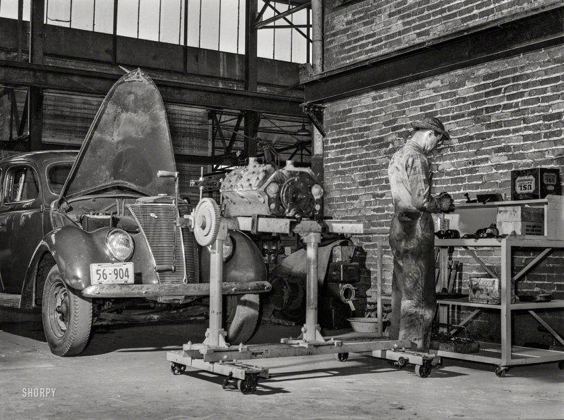 """May 1939. """"Repairing automobile motor at the FSA warehouse"""
