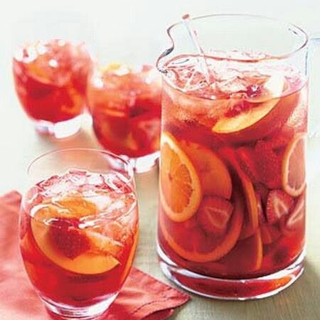 Strawberry Peach Sangria...yum! 4 C Moscato, 2 Lg Bottles Dry White Wine, 1C Strawberry Syrup, 2 C Peach Schnapps, 6 Cans Ginger Ale, Frozen Peaches, Frozen Strawberries (2 Bags of each)