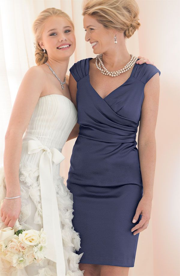 Short mother of the bride dresses for the summer months are normally sleeveless.  This open neck line cocktail dress is perfect for warm weather. See other #motherofthebridedresses at http://www.dariuscordell.com/featured_item/custom-made-mother-of-the-bride-evening-dresses/