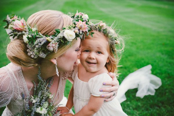 Adorable bride and flower girl photo by Caroline Ghetes | via junebugweddings.com