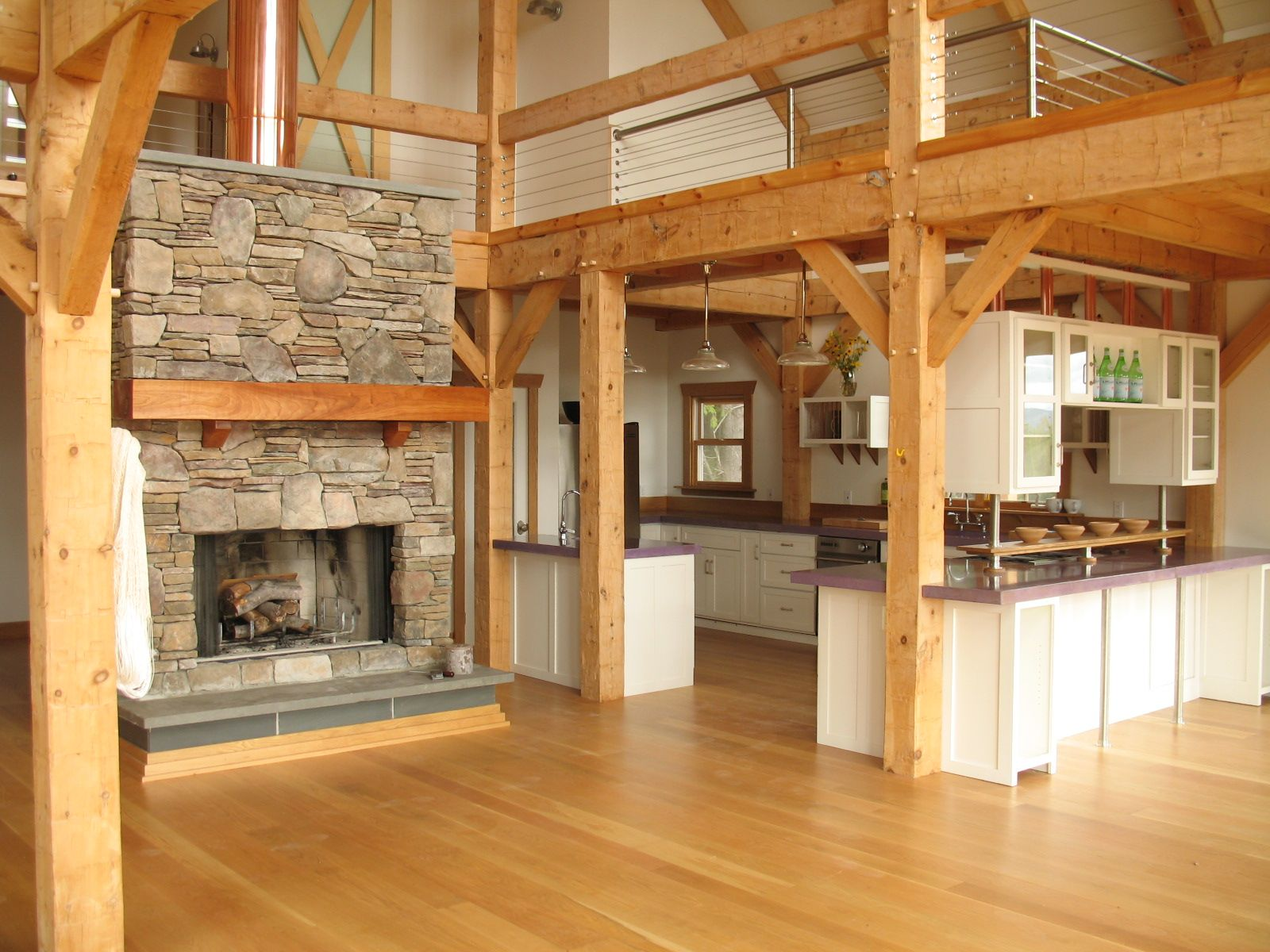 Homes that look like barns - Interior House With Wooden Pillars And Wooden Floor And Stone Fireplace Also Kitchen Room Designs Could Make A Pole Barn Home Look Like Timber Frame