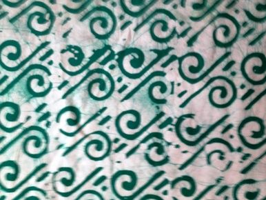 """Batik fabric white background green designs (Cott 394-B136). This fabric is 100% cotton. This fabric is sold by the yard (36""""w x 45""""l). Fat Quarters are available. Wholesale and international shipping."""