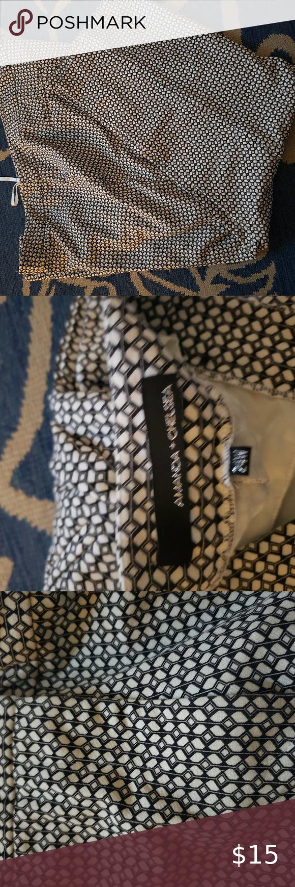 Amanda & Chelsea Black and White Slacks Black and white pattern slacks inseam 28 inches. Waist to hem is 37 1/2 inches. Amanda & Chelsea Pants Ankle & Cropped #whiteslacks