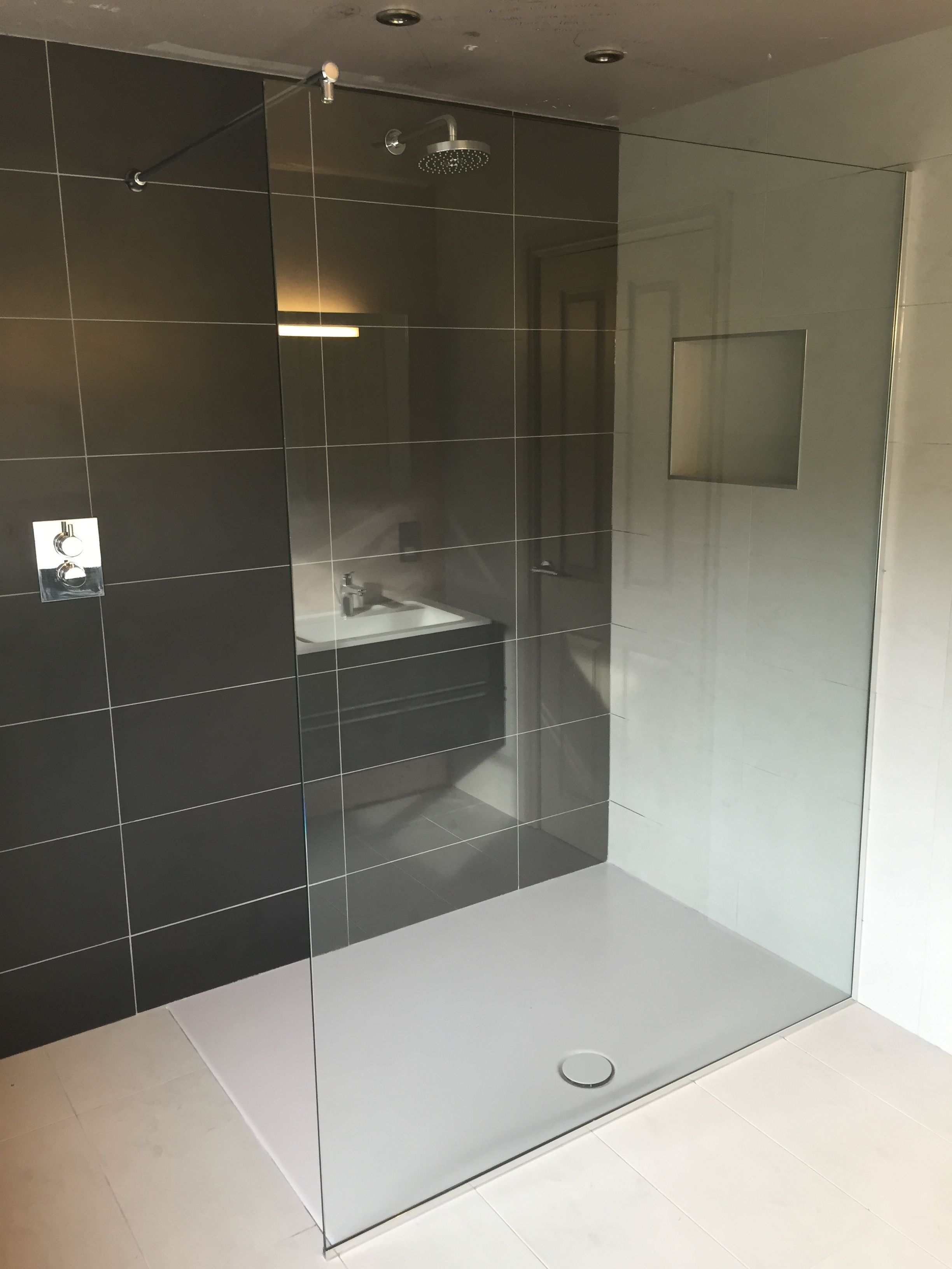 Fixed shower screen in 10mm clear toughened safety glass, installed ...