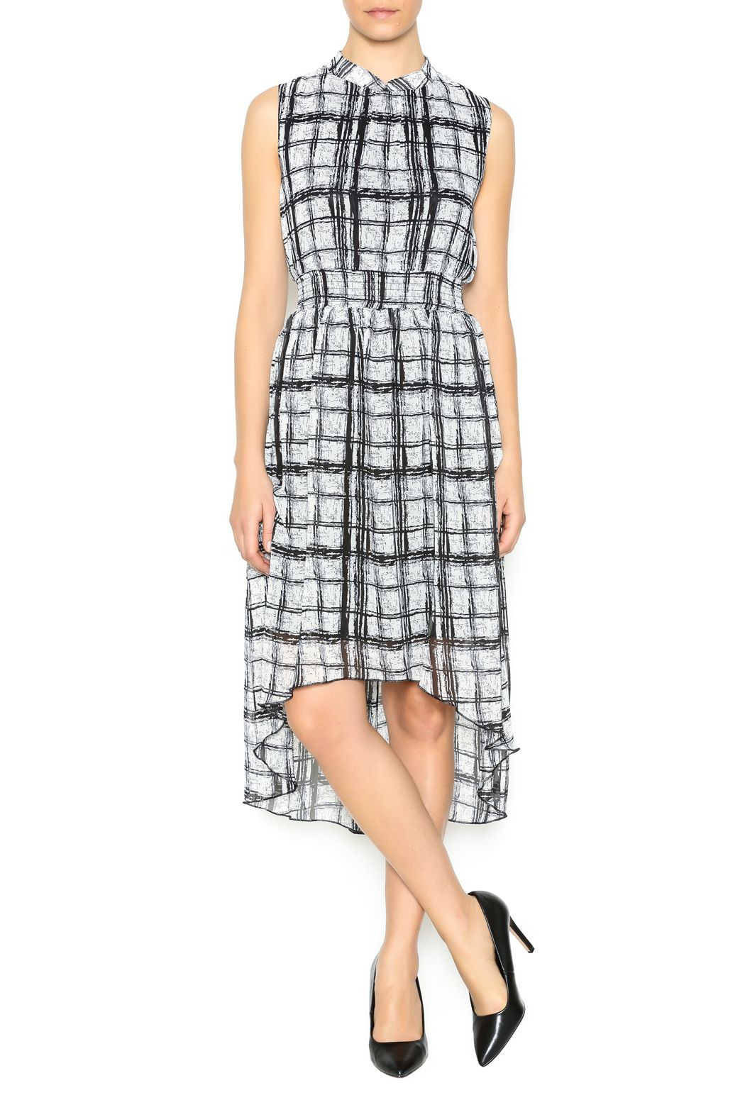White and black grid dress with elastic waist and high low hemline.