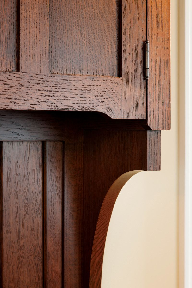 Quarter-sawn oak—shown here with a deep, expressive finish—is common in many turn-of-the-20th-century houses, from coast to coast.