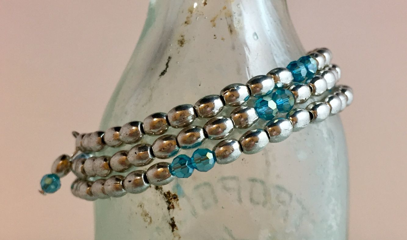 Wrap style, crystals, pewter with SS overlay.
