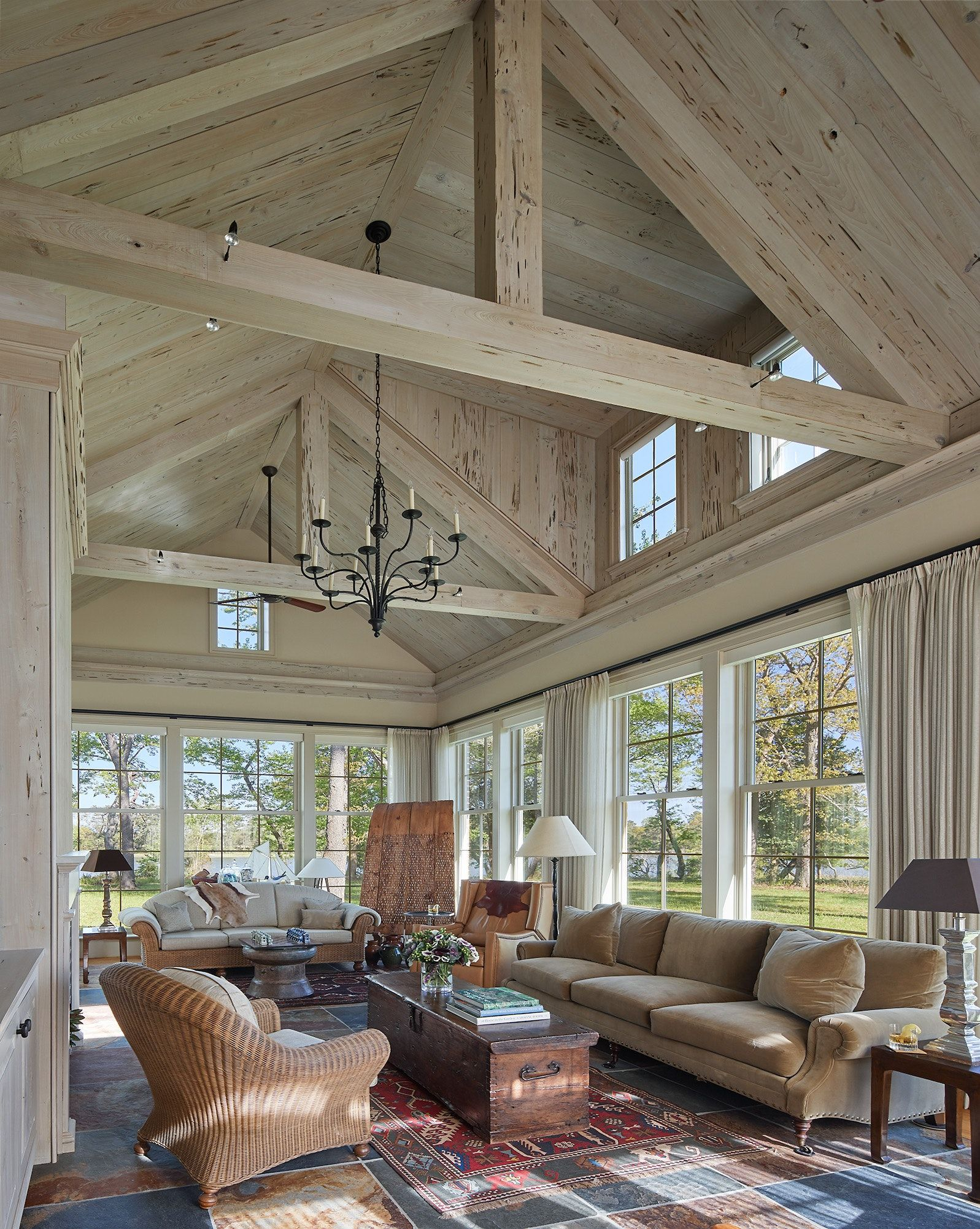 Great room at waterfront estate with beams and paneled cathedral