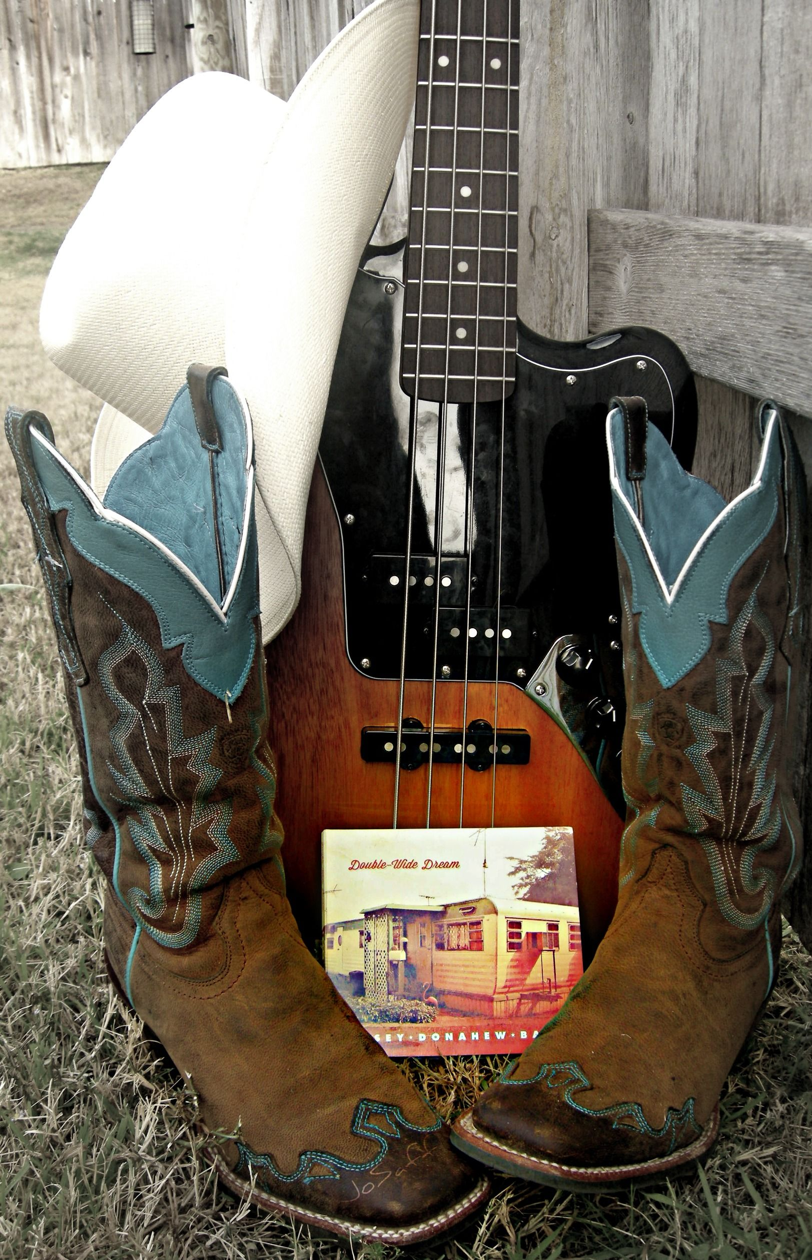 Boots cowboy and hat and guitar photo
