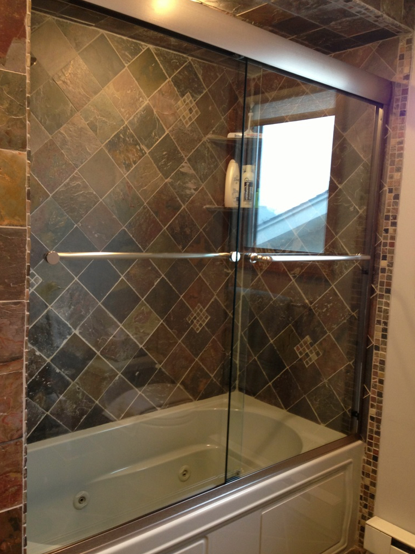 Frameless Glass Tub Enclosure with headrail. Beautiful tile work to ...