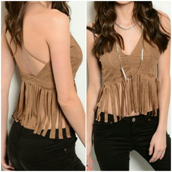 2cce00758ad Faux Suede Fringed Crop Top This sleeveless faux suede top features a  v-neckline and