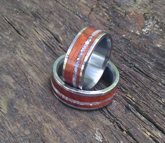 This set of custom made set of wedding rings is just gorgeous. Weve taken our hand milled and hand sized titanium rings and inlaid them with rosewood