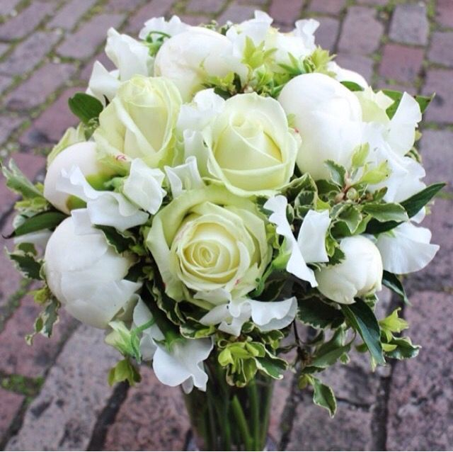 Simple and elegant with roses, peonies and sweet peas with a touch of varigated pittosporum.