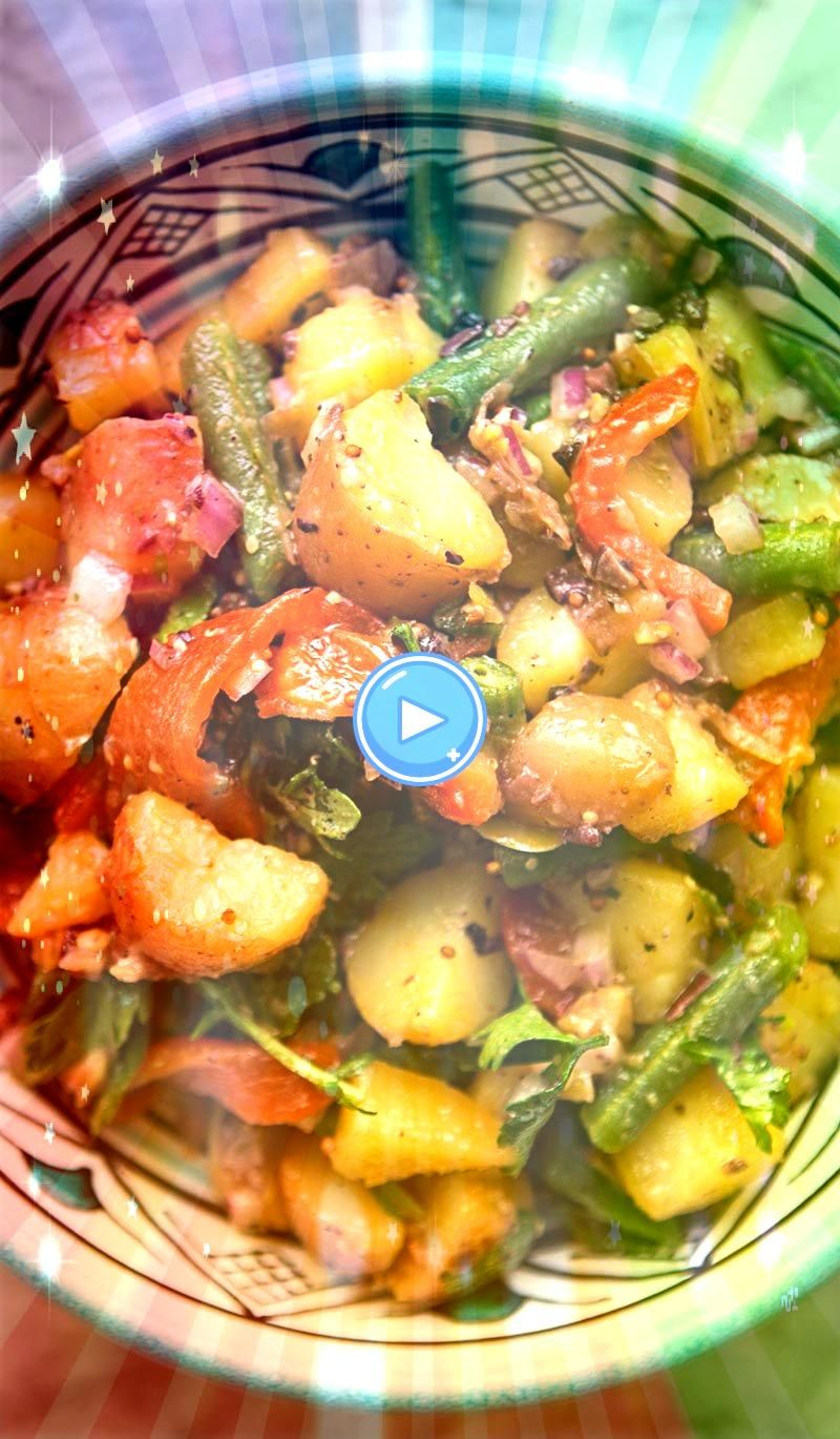 Mediterranean potato salad with new potatoes green beans roasted red bell peppers red onion olives parsley tossed in vinaigrette On Summery Mediterranean potato salad wit...