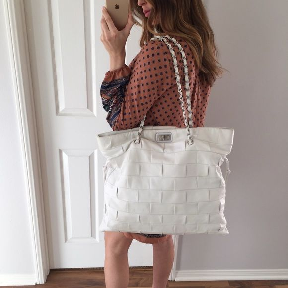 ce5a14cda433 White Chanel Quilted Leather Handbag 100% authentic Chanel Quilted Handbag.  Purchased from Neiman Marcus, Ca. Includes: Dust bag, NM tags, Chanel  booklets ...
