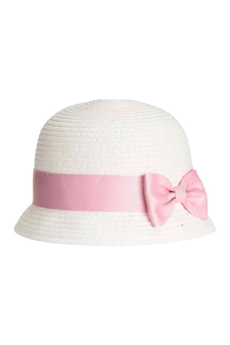Сламена шапка  Шапка от хартиена слама с рипсена лента с панделка. С  подплата от памук. e056f7692713