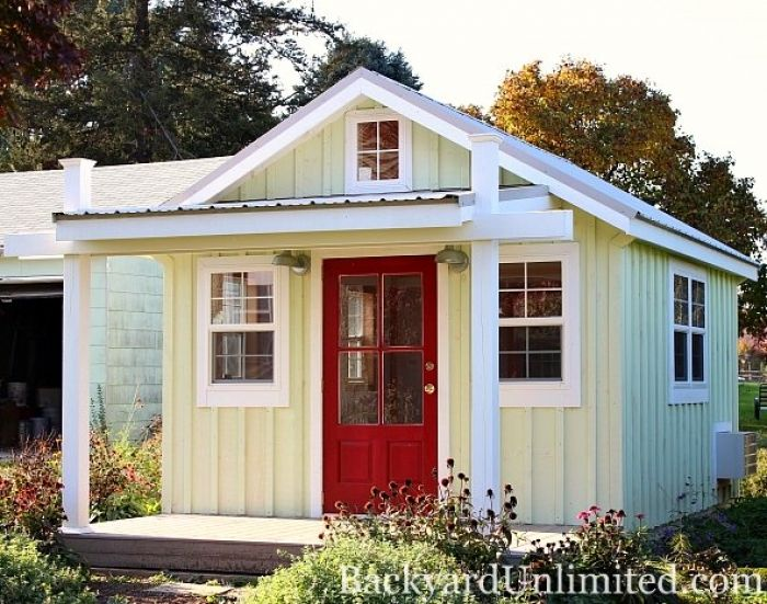 12x14 garden shed with metal roof board batten siding porch additional windows