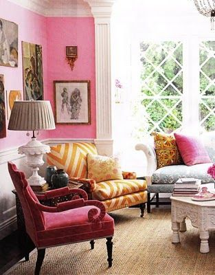 Enchanted with this color filled room pink chair walls chevron yellow stripes upholstered armchair and some neutral seagrass or other matting also sitting sala home decor casa decoracion pinterest rh
