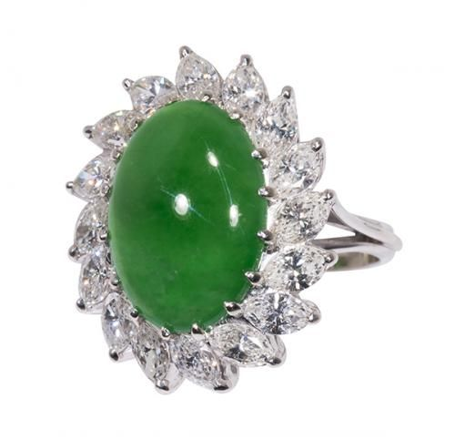 Jadeite, diamond and 14k white gold ring, Mason-Kay 'A' jade report , Mason-Kay 'A' jade report centering one #oval #green #jadeite #cabochon measuring approximately 15.35 x 10.84 x 4.84 mm, surrounded by (16) #marquise-cut diamonds, weighing a total of approximately 2.40 cts., set in a #14k #white #gold mounting, size 6. Estimate: $18,000- $25,000