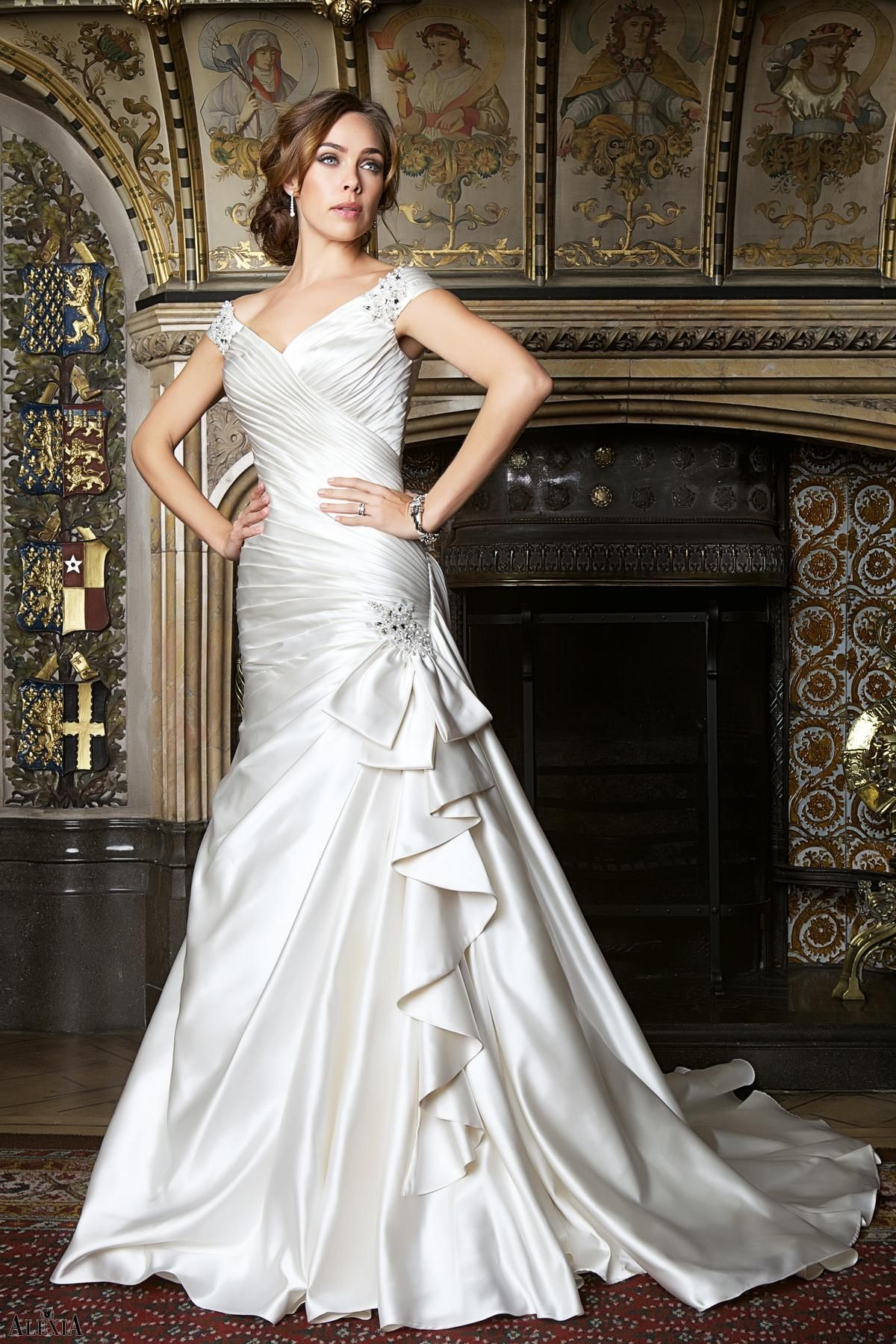 Smooth satin bridal gown with perfect pleating, crystal