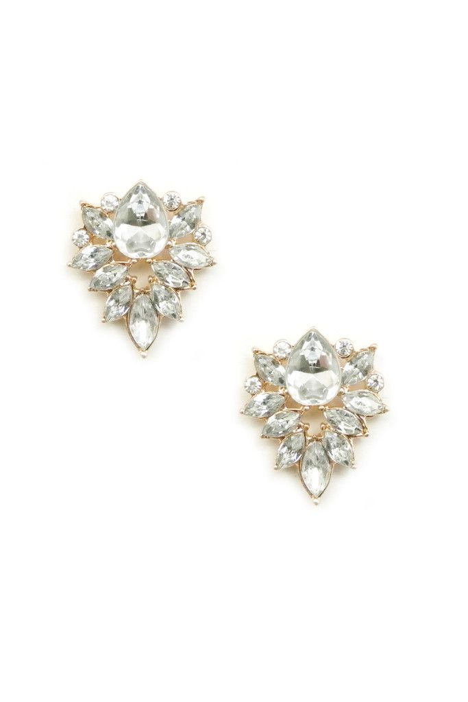 Get this gorgeous earring pair with a clear cut stone with surrounding crystal stones. This earring comes in two colors - Silver and Gold. The earring is approximately 1 inch with a post backing.