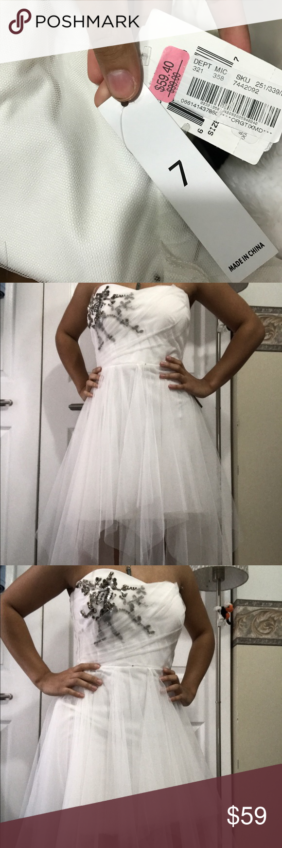 White prom dress white with sequenced jewels on top right breast