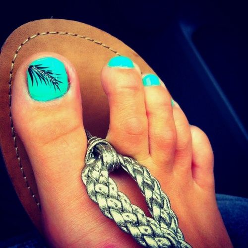 Teal with black feather, toe nail design - The Perfect Color On Your Toes With An Awesome Feather Accent