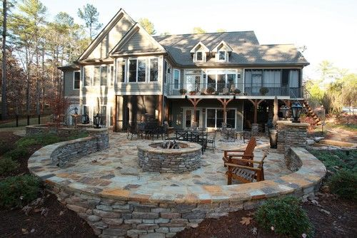 An Outdoor Hangout Area With A Fire Pit Wooden Chairs Glass Tables Delectable Interior Design Firms In Atlanta Exterior