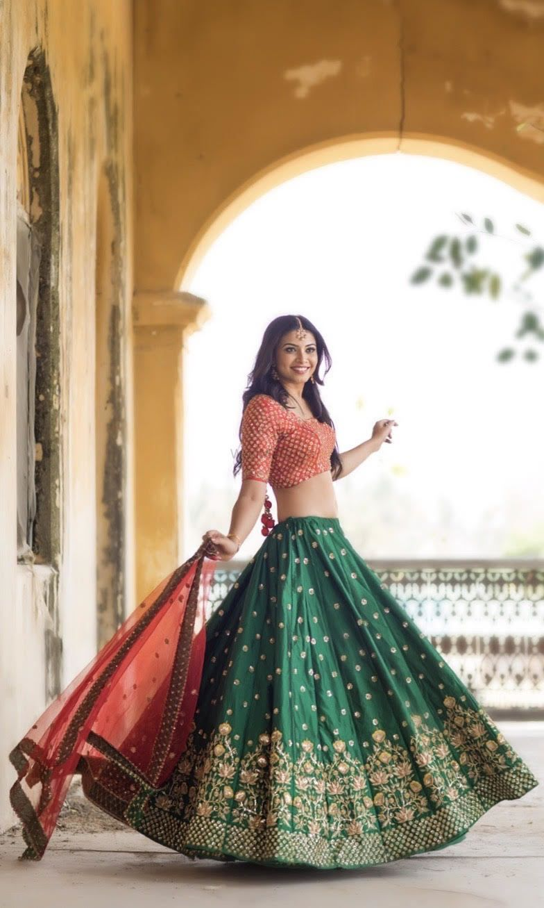 b361bef745 Dark green lehenga for mehendi with small motifs and red blouse and dupatta