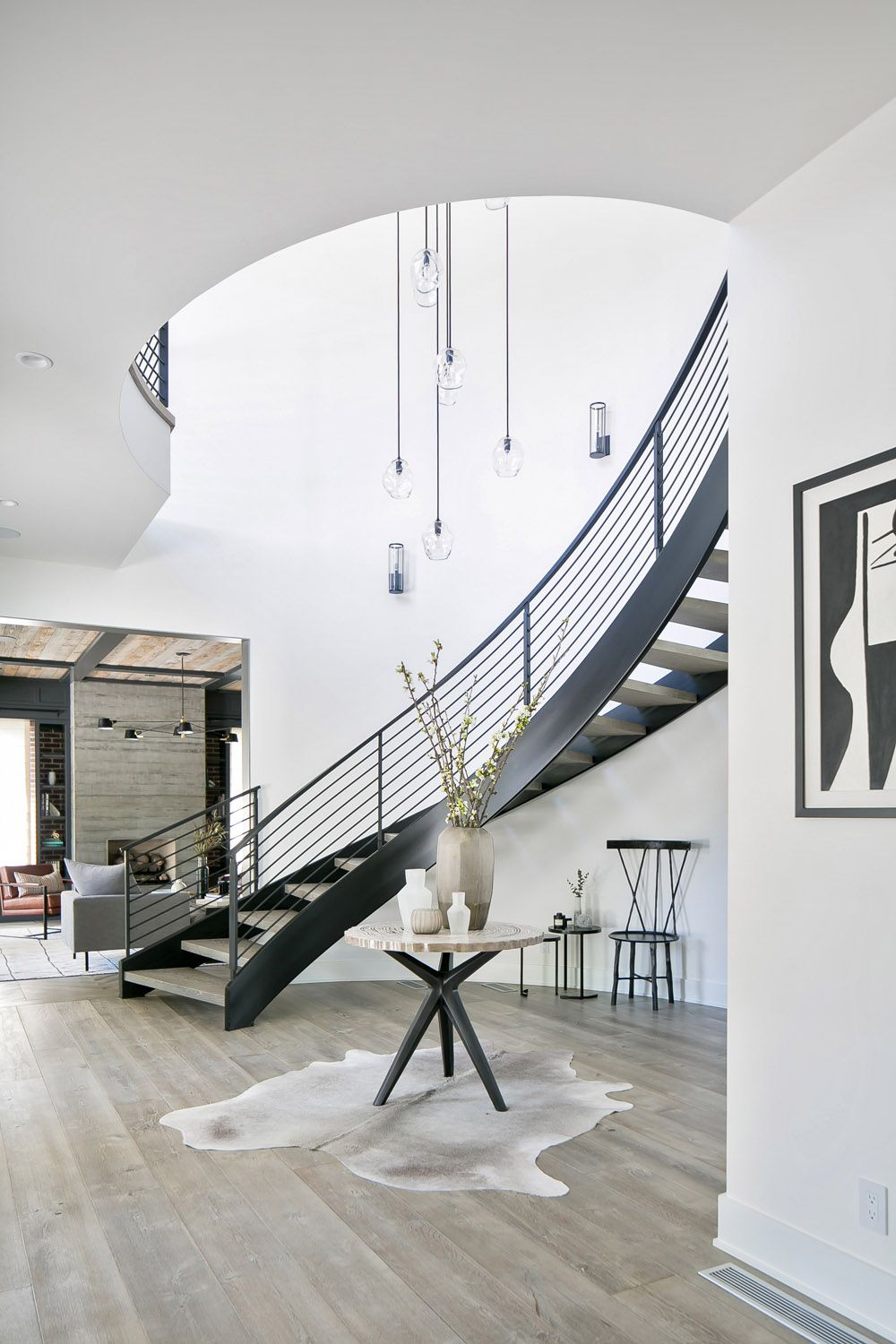 Best Black Modern Curved Staircase With A Double Ceiling Height 400 x 300