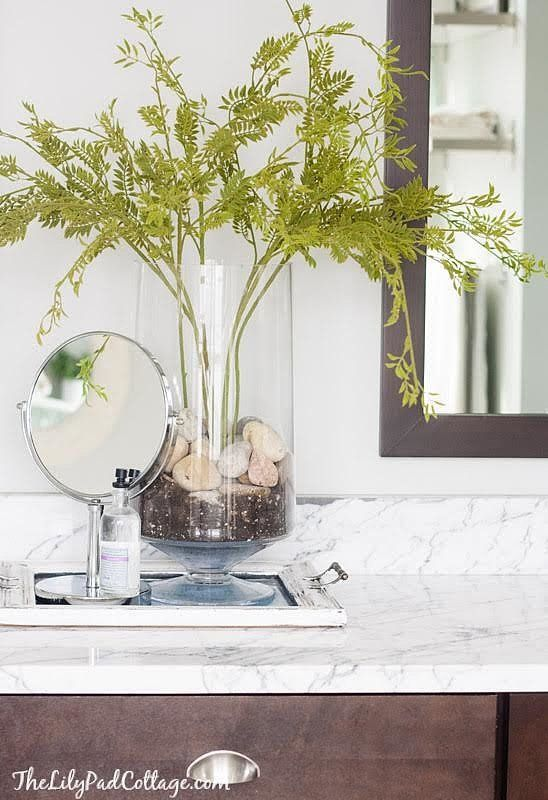 What Is A Gl Vase Full Of Faux Flowers With No Water Surrounding The Stems Quick Way To Spoil Your Secret That S Anchor Plant Or