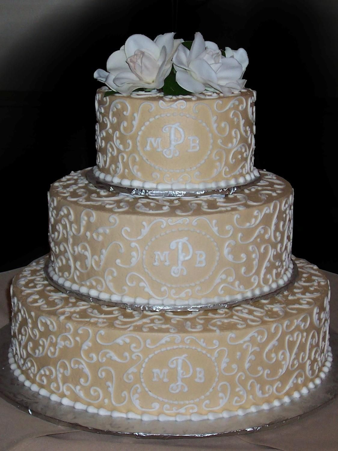 Champagne gold buttercream iced 3 tiered wedding cake