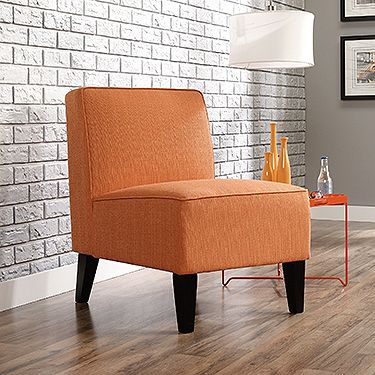 Brighten up any room with a trend-setting orange accent chair. This plush chair will add unique style to your home.