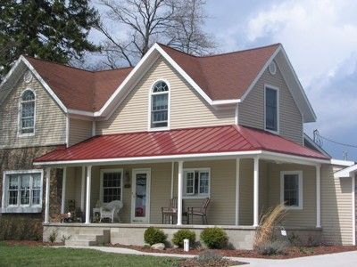 Colonial red standing seam metal roof colonial red metal for Red brick house with metal roof