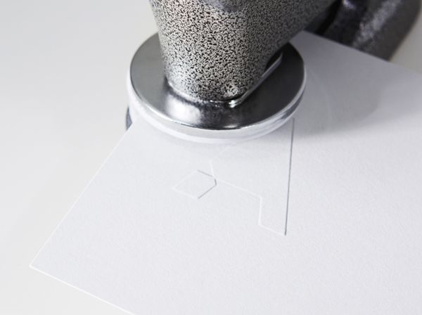 Logo and blind embossed stationery created by Blok for Atelier af.