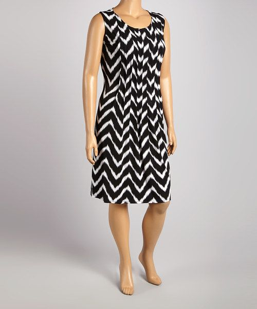 take a look at the glamour black & white pleated sleeveless dress