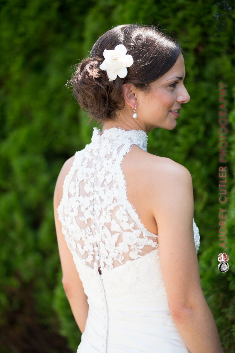 Gorgeous Bride High Neck Wedding Dress Wedding Ideas Pearl Earrings Up Do Bun Wedding Hair