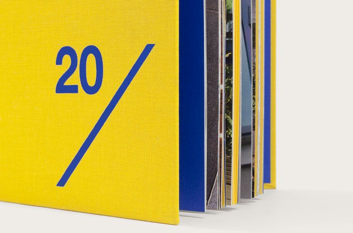 Matt blue foil on yellow fabric cover of anniversary book for