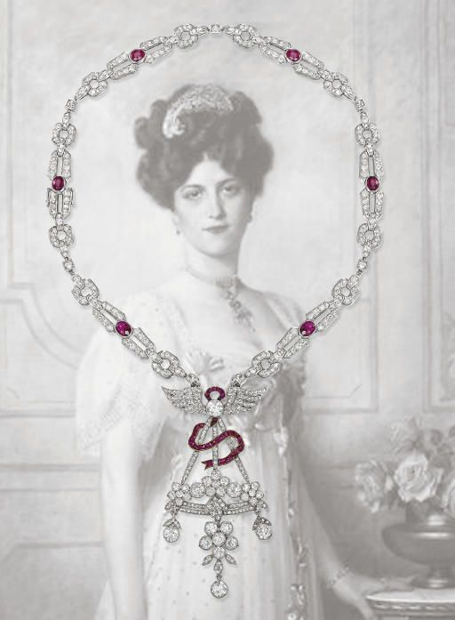 AN EARLY 20TH CENTURY DIAMOND AND RUBY PENDENT NECKLACE   The Belle Epoque pendant designed as a stylised basket of flowers with diamond collet and floral drops to the calibré-cut ruby ribbon and diamond winged surmount, suspended from a later Art Deco diamond-link necklace with oval-cut ruby spacers, pendant circa 1905, necklace circa 1925, 45.0 cm long [Not too thrilled with the background on this one]